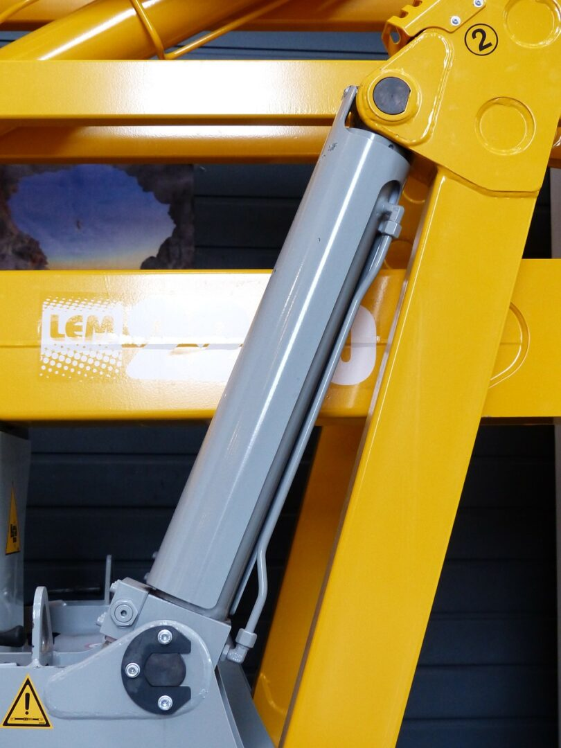 Yellow hydraulic cylinder