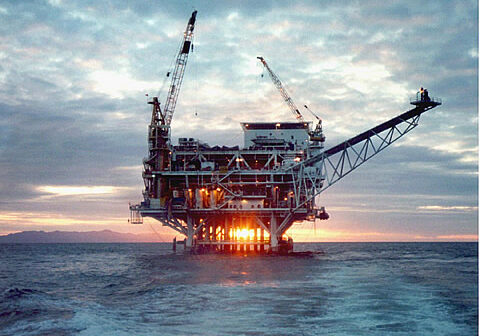 Ocean oil rig picture at sunset