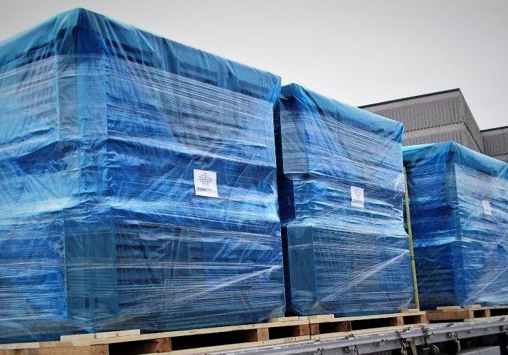 Transport truck loaded with pallets packaged in vci corrosion prevention blue film