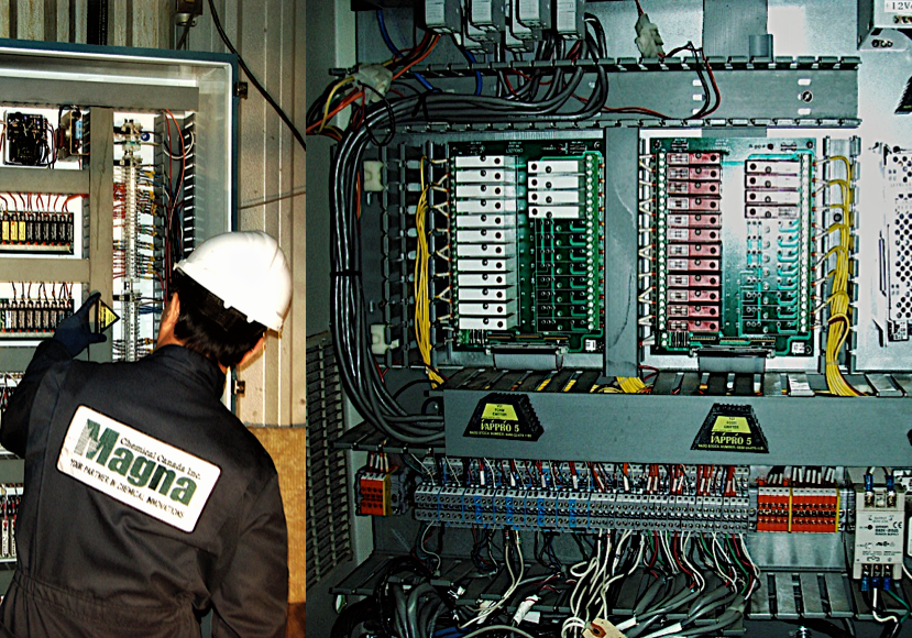Man installing Vappro 5 and Vappro 10 VCI emitters in large electrical panels