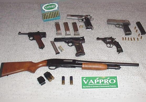 Assotment of firearms lying on a table