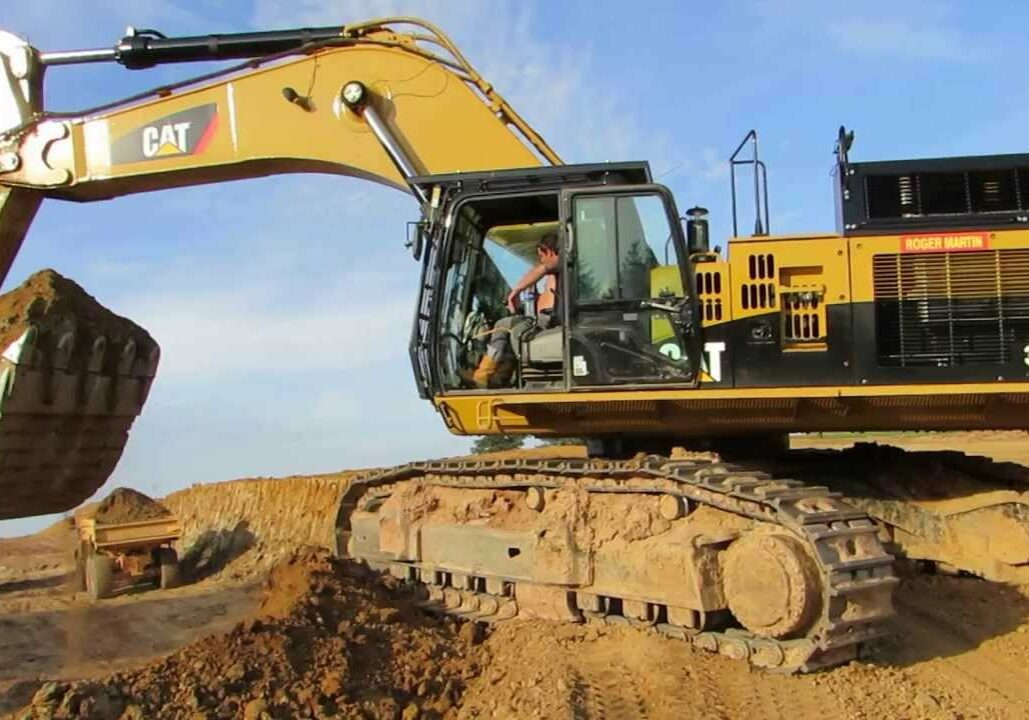 Escavator digging in the ground