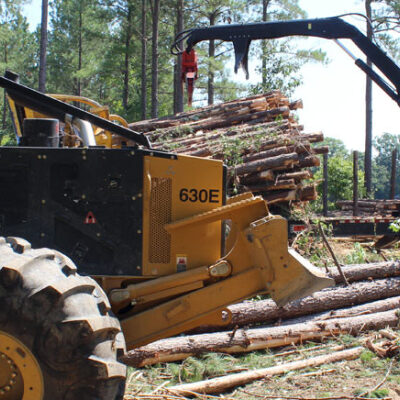 Forestry equipment at work in woodlot with VCI corrosion prevention